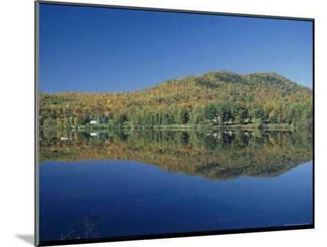 A Lake Surrounded by Trees Displaying the Colors of Autumn-Richard Nowitz-Mounted Photographic Print