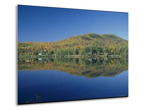 A Lake Surrounded by Trees Displaying the Colors of Autumn-Richard Nowitz-Metal Print
