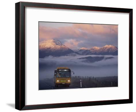Bus at Sunrise with the Mountains Covered in a Blanket of Fog-Annie Griffiths-Framed Art Print