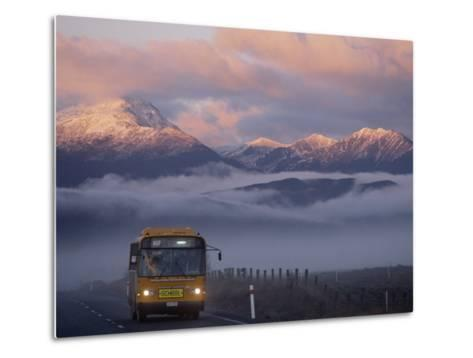 Bus at Sunrise with the Mountains Covered in a Blanket of Fog-Annie Griffiths-Metal Print