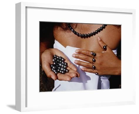 A Tahitian Woman Displaying an Assortment of Black Pearls-Paul Chesley-Framed Art Print