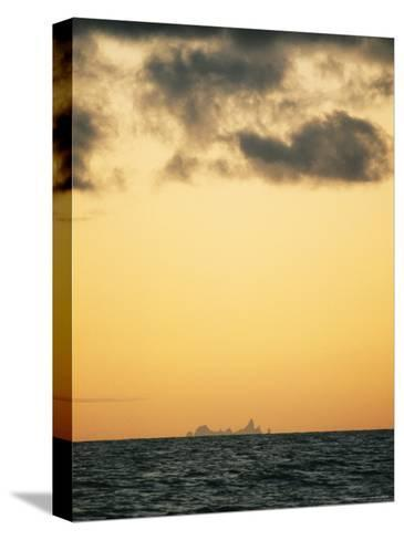 Distant View of Tubuai Island-Luis Marden-Stretched Canvas Print