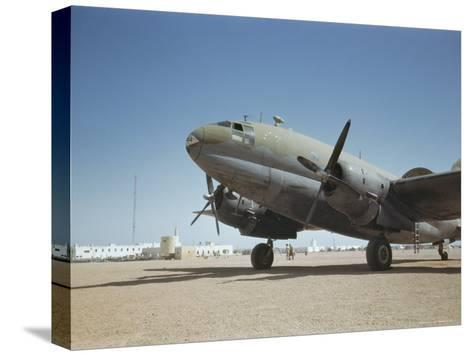 A C-46 at the Airport in Rio De Oro-Maynard Owen Williams-Stretched Canvas Print