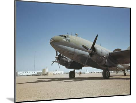 A C-46 at the Airport in Rio De Oro-Maynard Owen Williams-Mounted Photographic Print