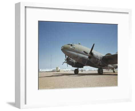 A C-46 at the Airport in Rio De Oro-Maynard Owen Williams-Framed Art Print