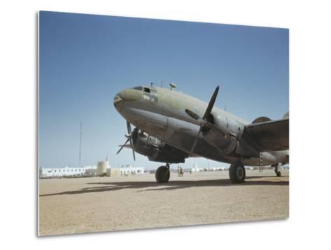 A C-46 at the Airport in Rio De Oro-Maynard Owen Williams-Metal Print