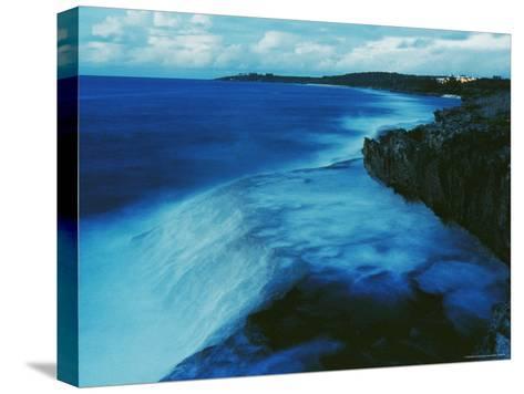 Waves Crash against a Reef-Sisse Brimberg-Stretched Canvas Print