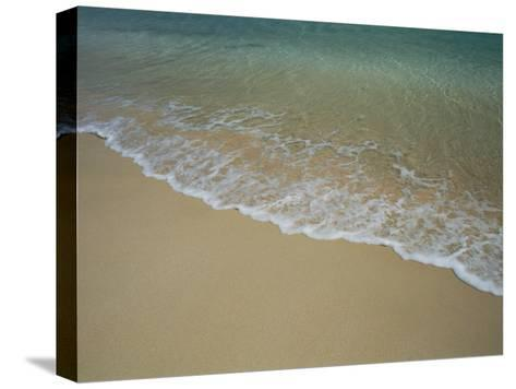 A View of Surf Creeping up onto a Beach-Todd Gipstein-Stretched Canvas Print