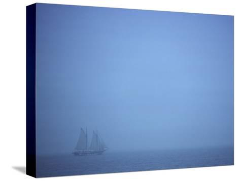 A Schooner Ship Sails Through Dense Fog off the Coast of New England-Todd Gipstein-Stretched Canvas Print