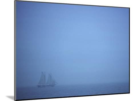 A Schooner Ship Sails Through Dense Fog off the Coast of New England-Todd Gipstein-Mounted Photographic Print