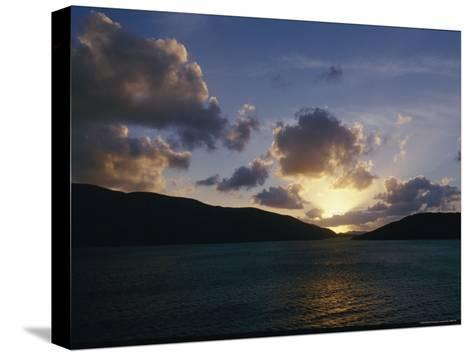 The Sun Hides Behind a Cloud Low in the Sky-Todd Gipstein-Stretched Canvas Print