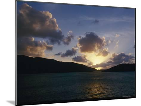 The Sun Hides Behind a Cloud Low in the Sky-Todd Gipstein-Mounted Photographic Print