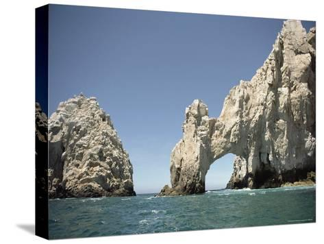 A Natural Arch over the Water-Luis Marden-Stretched Canvas Print