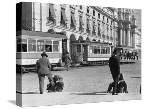 Bootblacks at Work in Front of the Ministry of Marine on the Praca Do Comercio in 1936-W^ Robert Moore-Stretched Canvas Print