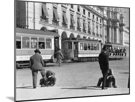 Bootblacks at Work in Front of the Ministry of Marine on the Praca Do Comercio in 1936-W^ Robert Moore-Mounted Photographic Print