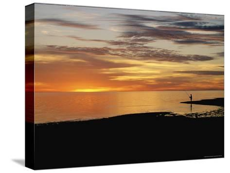 Sunset over a Distant Fisherman-Clarita Berger-Stretched Canvas Print