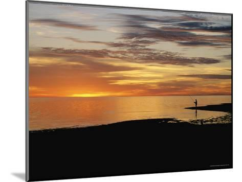 Sunset over a Distant Fisherman-Clarita Berger-Mounted Photographic Print