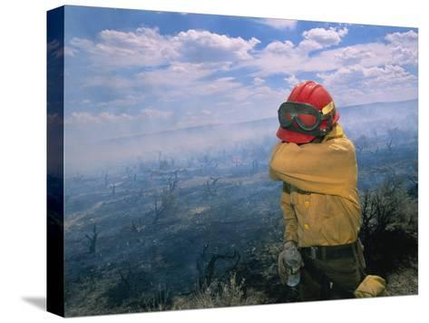 A Fire-Fighter Wipes His Smoke-Irritated Eyes-Mark Thiessen-Stretched Canvas Print