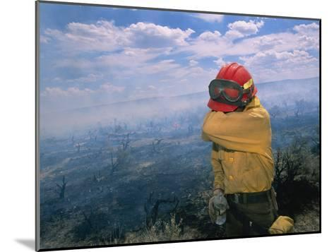 A Fire-Fighter Wipes His Smoke-Irritated Eyes-Mark Thiessen-Mounted Photographic Print