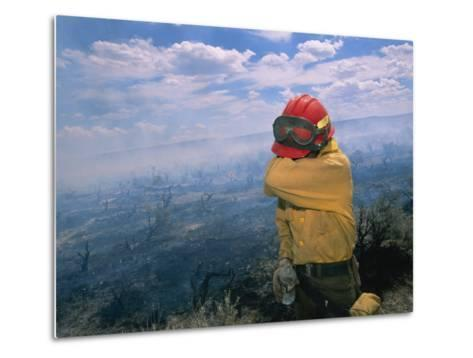 A Fire-Fighter Wipes His Smoke-Irritated Eyes-Mark Thiessen-Metal Print