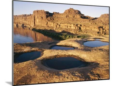 View of Water-Filled Depressions in Rock Formations Near the Colorado River-Stephen Alvarez-Mounted Photographic Print