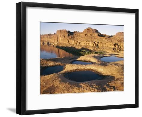 View of Water-Filled Depressions in Rock Formations Near the Colorado River-Stephen Alvarez-Framed Art Print