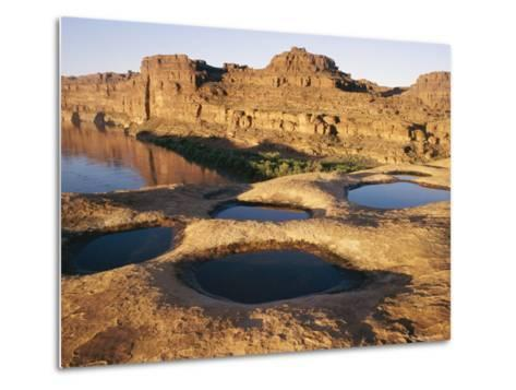View of Water-Filled Depressions in Rock Formations Near the Colorado River-Stephen Alvarez-Metal Print