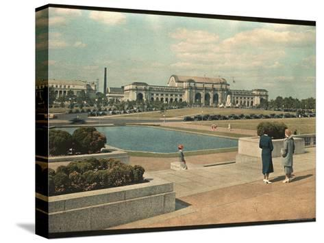 Two Women Look Across Captial Park and its Reflecting Pool Toward Union Station-Willard Culver-Stretched Canvas Print