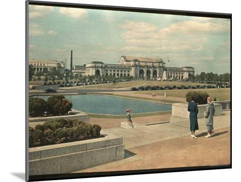 Two Women Look Across Captial Park and its Reflecting Pool Toward Union Station-Willard Culver-Mounted Photographic Print