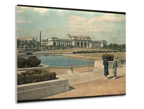 Two Women Look Across Captial Park and its Reflecting Pool Toward Union Station-Willard Culver-Metal Print