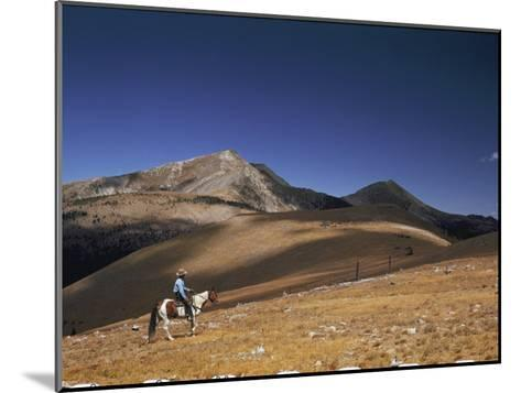 A Horseman Views the Truchas Peaks from Above the Timberline-Justin Locke-Mounted Photographic Print