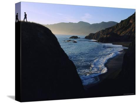 A Person Stands on an Overlook Above a Rocky Shoreline-Melissa Farlow-Stretched Canvas Print