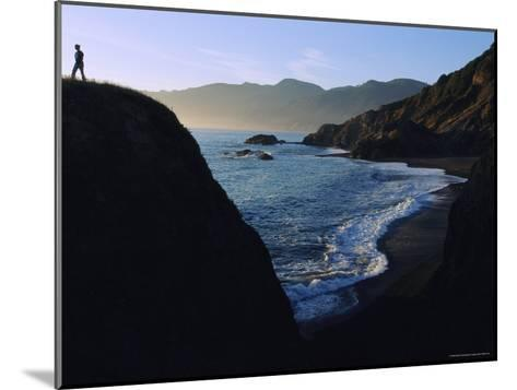 A Person Stands on an Overlook Above a Rocky Shoreline-Melissa Farlow-Mounted Photographic Print