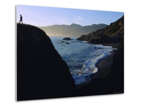 A Person Stands on an Overlook Above a Rocky Shoreline-Melissa Farlow-Metal Print