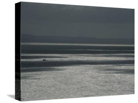 A Fishing Boat on the Vast Waters of Alitak Bay-George F^ Mobley-Stretched Canvas Print