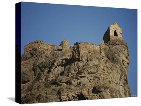 A Ruined Fortress Stands Upon a Rocky Hill-Stephen Alvarez-Stretched Canvas Print