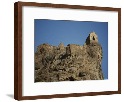 A Ruined Fortress Stands Upon a Rocky Hill-Stephen Alvarez-Framed Art Print