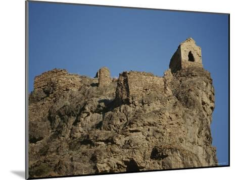 A Ruined Fortress Stands Upon a Rocky Hill-Stephen Alvarez-Mounted Photographic Print