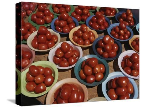 Roma Tomatoes Fill Colorful Bowls at a Vendors Stall-Tino Soriano-Stretched Canvas Print