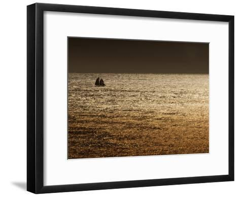 A Sailing Ship Crosses Waters Turned Gold by the Setting Sun-Sam Abell-Framed Art Print