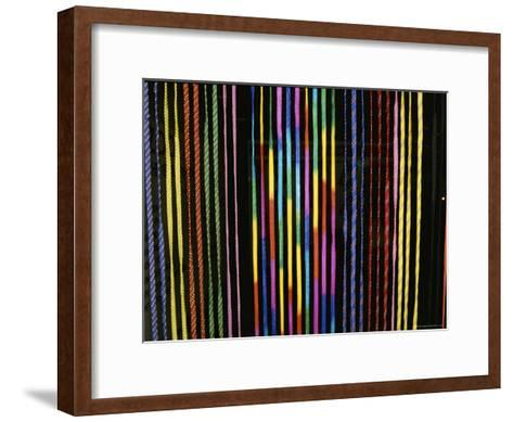 Colorful Strings in a Shop in Manila-Wolcott Henry-Framed Art Print
