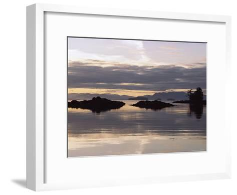 Islands and Clouds Reflect on a Calm Sea at Kah Shakes Cove-Bill Curtsinger-Framed Art Print