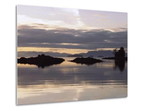 Islands and Clouds Reflect on a Calm Sea at Kah Shakes Cove-Bill Curtsinger-Metal Print