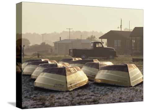 Rows of Upturned Wooden Rowboats on Chincoteague Island-Medford Taylor-Stretched Canvas Print