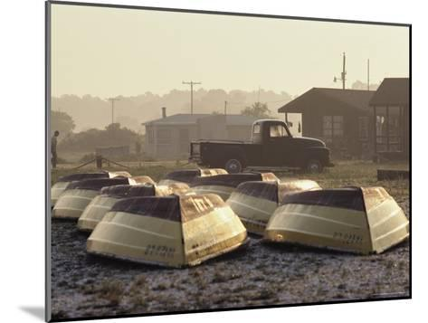 Rows of Upturned Wooden Rowboats on Chincoteague Island-Medford Taylor-Mounted Photographic Print