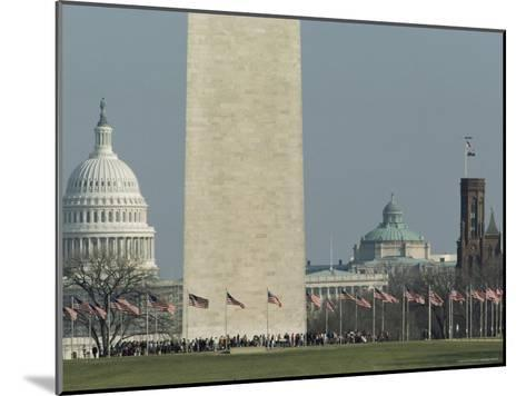Tourists and Flags Surrounding the Base of the Washington Monument--Mounted Photographic Print