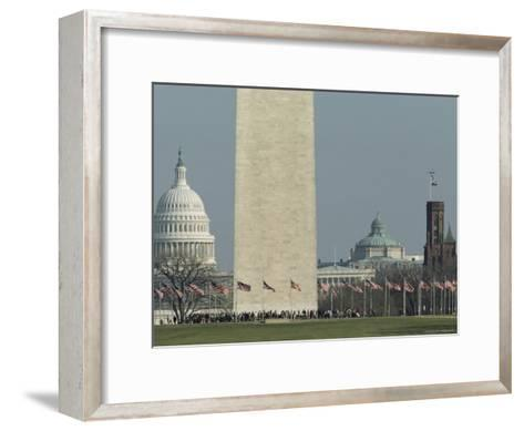 Tourists and Flags Surrounding the Base of the Washington Monument--Framed Art Print