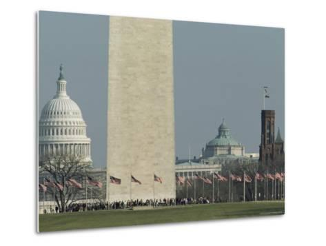 Tourists and Flags Surrounding the Base of the Washington Monument--Metal Print
