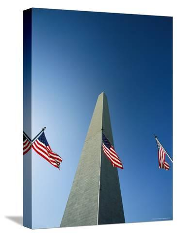 View from the Ground of the Washington Monument and American Flags-Kenneth Garrett-Stretched Canvas Print