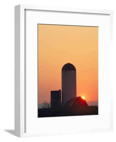 Twilight View of a Barn and Silo Silhouetted against the Sun-Kenneth Garrett-Framed Art Print